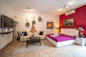 Naumachie Suite Apartment and Garden - AbcAlberghi.com