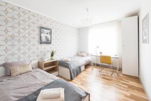 Apartament Kalinowo z parkingiem na pilota pokój z sofą z opcją spania kuchnia i 2 sypialnie