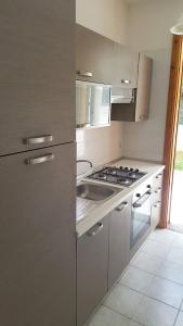 Villa trilo con doppio giardino 26, Дома для отпуска  Торре-дель'Орсо - big - 2