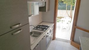 Villa trilo con doppio giardino 26, Дома для отпуска  Торре-дель'Орсо - big - 9