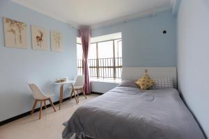 Guiyang Enjoy The Time Guest House, Hostelek  Kujjang - big - 25