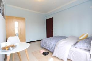 Guiyang Enjoy The Time Guest House, Hostelek  Kujjang - big - 11
