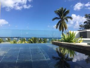 . Latitude Seafront Penthouse with Private Plunge Pool