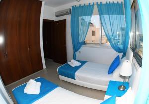 Villa Helen,Colonian beach villas, Vily  Meneou - big - 4