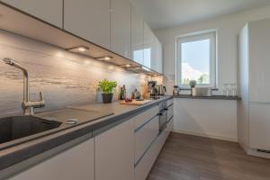 Ferienwohnungen Rosengarten, Апартаменты  Бёргеренде-Ретвиш - big - 176