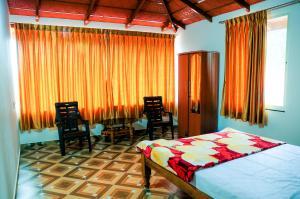 The Mayuravana Homestay, Проживание в семье  Чикмагалур - big - 2