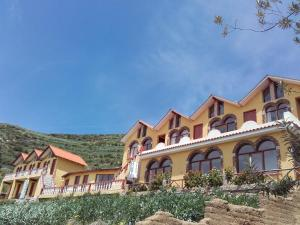 Hostal Mirador del Inca, Гостевые дома  Комунидад-Юмани - big - 1