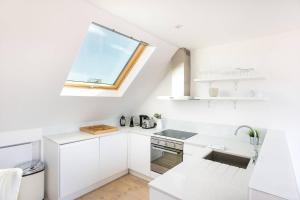 Luxury Top Floor Home In West Kensington W/Terrace, Ferienwohnungen  London - big - 20