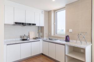 WeiHai Emily Seaview Holiday Apartment International Bathing Beach, Ferienwohnungen  Weihai - big - 59