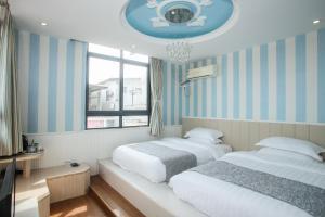 Xiamen Aishang Inn, Homestays  Xiamen - big - 37