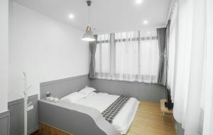 Xiamen Aishang Inn, Homestays  Xiamen - big - 10
