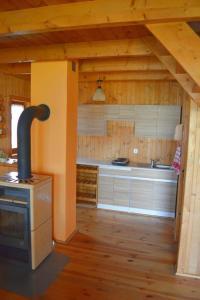 Domek drewniany i pokoje gościnne Kasia