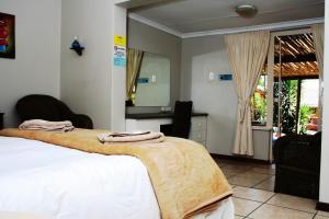 Flintstones Guesthouse Fourways, Penzióny  Johannesburg - big - 3