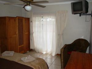 Flintstones Guesthouse Fourways, Penzióny  Johannesburg - big - 50