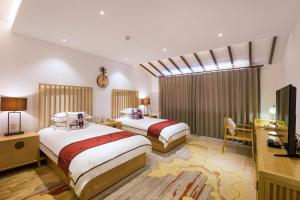 Auberges de jeunesse - Longmen Impression Hotel