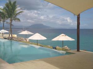 Beach Front Infiniti Blu Condo, Sosúa