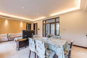 Sanya Yuelanwan Holiday Home, Prázdninové domy  San-ja - big - 16
