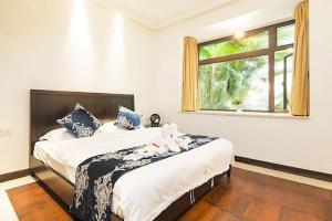Sanya Yuelanwan Holiday Home, Prázdninové domy  San-ja - big - 34