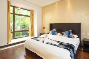 Sanya Yuelanwan Holiday Home, Prázdninové domy  San-ja - big - 35
