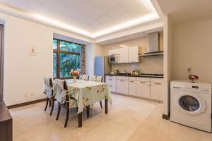 Sanya Yuelanwan Holiday Home, Prázdninové domy  San-ja - big - 20