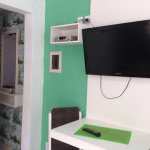 Residencial Gringos Verde e Laranja, Апартаменты  Бомбиньяс - big - 16