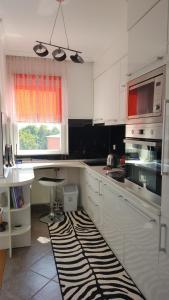 apartman stadion, Appartamenti  Tuzla - big - 9