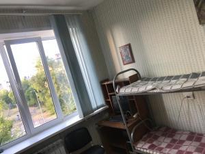Номер (Спальное место на двухъярусной кровати в общем номере для женщин)