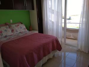Casa Rosada, Alloggi in famiglia  Florianópolis - big - 3