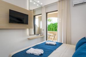 Marinos Beach Hotel-Apartments, Апарт-отели  Платанес - big - 85