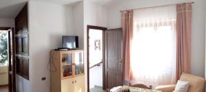 Appartamento Ottiolu Mare - AbcAlberghi.com