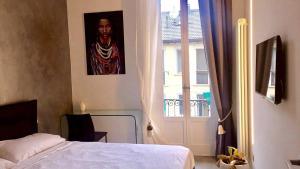 Double Pretty Room- Corso Buenos Aires - AbcAlberghi.com