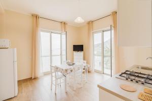 Villagonia Beach Apartments - AbcAlberghi.com
