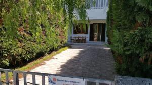 Villa trilo con doppio giardino 26, Prázdninové domy - Torre dell'Orso
