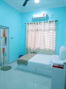 AUZ Guest House, Affittacamere  Kampong Kubang Palas - big - 10