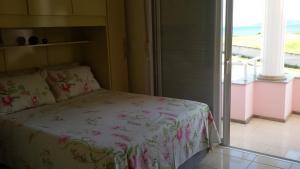 Casa Rosada, Alloggi in famiglia  Florianópolis - big - 18