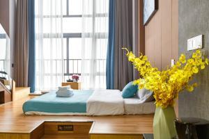 Lavendar Duplex Apartment, Apartments  Guangzhou - big - 13