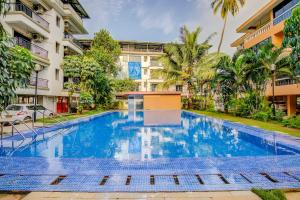 Apartment with a pool in Arpora, Goa, by GuestHouser 2097