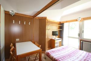Artuik Appartamenti Montana - AbcAlberghi.com