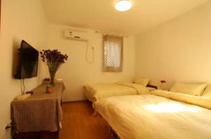 Dengba International Youth Hostel Jinan Branch, Хостелы  Цзинань - big - 8