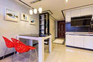 Changlong Star Loft Apartment, Apartmanok  Kuangcsou - big - 71