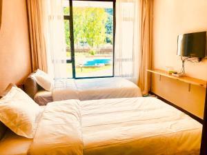 Hostels und Jugendherbergen - Lu Gu Hu Long Tang Inn