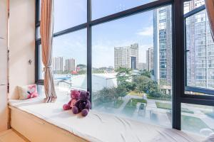 Changlong Star Loft Apartment, Apartmanok  Kuangcsou - big - 65