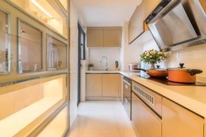 Rongyi Apartment, Апартаменты/квартиры  Гуанчжоу - big - 30