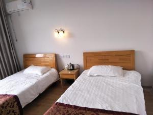 Hostales Baratos - Mingtangshan Henghe Guesthouse
