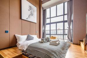 Lavendar Duplex Apartment, Apartments  Guangzhou - big - 47