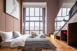Lavendar Duplex Apartment, Apartments  Guangzhou - big - 33