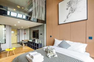 Lavendar Duplex Apartment, Apartments  Guangzhou - big - 46