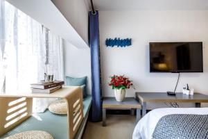 Rongyi Apartment, Апартаменты/квартиры  Гуанчжоу - big - 45