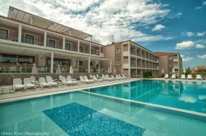 Arty Grand Hotel, Олимпия
