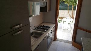 Villa trilo con doppio giardino 26, Дома для отпуска  Торре-дель'Орсо - big - 18
